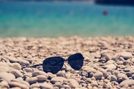 oludeniz: Glasses on the pebbles beach in Oludeniz Turkey