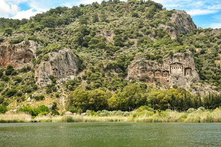 Lycian rock cut tombs at Dalyan, Turkey, were built BC. They were built in stones, at the cost of Dalyan Bogazi river. Stock Photo