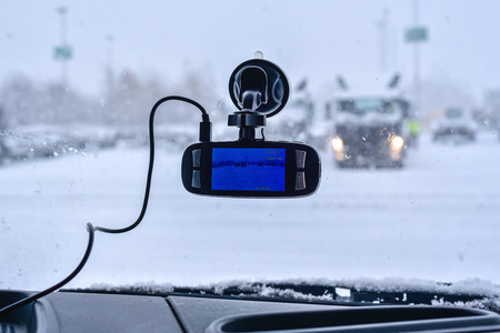 A car dash cam mounted on the front windshield recording the traffic ahead Stock Photo