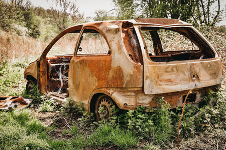 Devastated burned car wrack. Effects of an accident