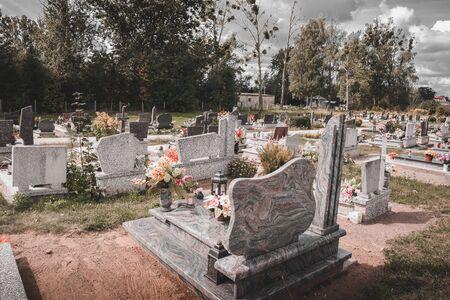 Tombstone, memorials and headstones and flowers in cemetery-graveyard 写真素材