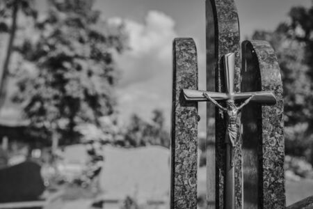 Tombstone, memorials and headstones and flowers in cemetery-graveyard in black and white 写真素材
