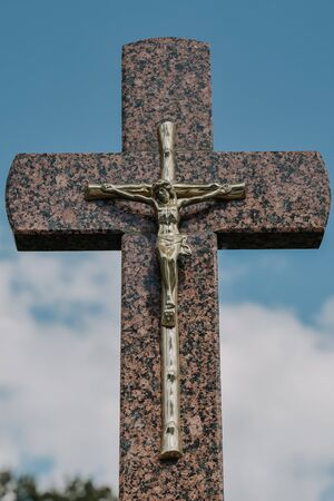 A old cementry with graveyards and crosses with Jesus on cross 写真素材