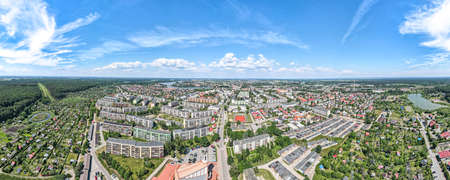 Photo taken from drone, panoramic view of Ilawa town in Poland and surrouding area, Jeziorak lake.