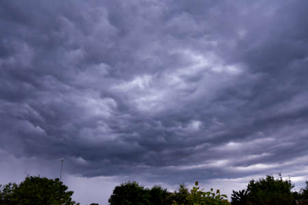 Dramatic dark sky and clouds. Cloudy sky background. Sky before thunder storm and rain.