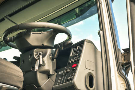 Underneath view of open cab interior big truck with steering wheel on front Stock Photo