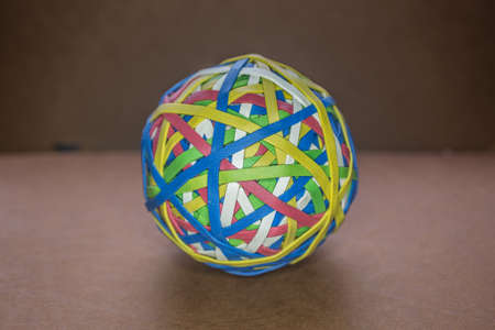 Rubber bands of different colors stretched into a ball