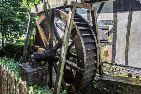 Half-timbered greening with water wheel