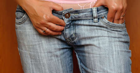 pubis: Sexy woman body in blue jean shorts