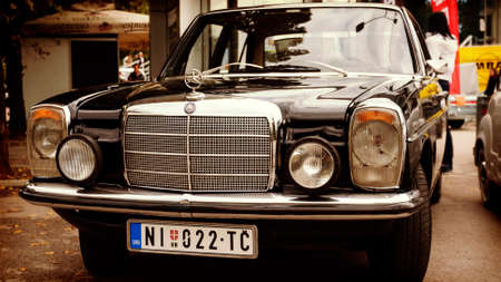 shiny car: Nis, Serbia - October 08, 2016: Old timer Mercedes 200 series produced in 1975 with chrome parts of the body and distinctive design.