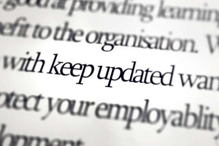 The word Keep Updated with lens blur