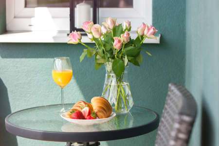Freshly squeezed juice with croissant and fruits sunny morning breakfast idea