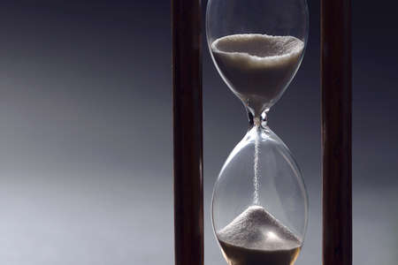 Hourglass as time passing concept for business studying deadline, urgency and running out of time. Reklamní fotografie