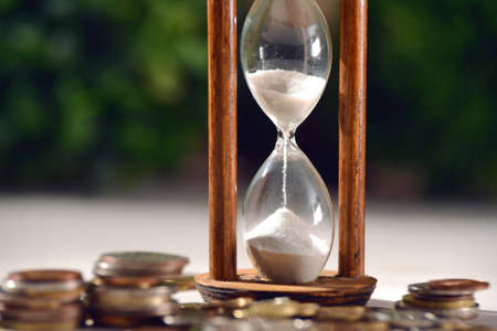 Hourglass as time passing concept for finances investments 스톡 콘텐츠