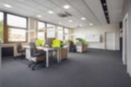 Office background - blurred and defocused - ideal for business presentation background textspace