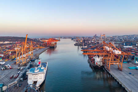 03.04.2020 Gdynia Logistics and transportation of containers. Cargo ship with crane bridge. Import, export industry aerial view from drone, from above