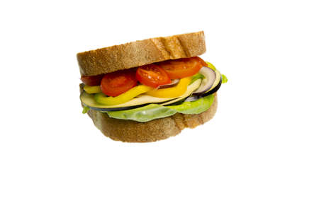 Sandwitch made with lettuce, tomato, eggplant, yellow peppers and onion isolated on white background Stock Photo