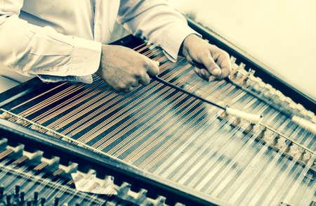 lug: Italy, Lug 2013  Musician playing an old instrument Stock Photo