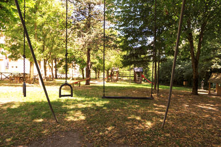 View of a Playground  in the middle of trees