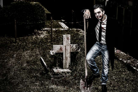 Vampire over a grave at the cemetery, Halloween Collection