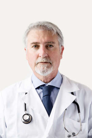 Portrait of a senior doctor against white background Stock Photo
