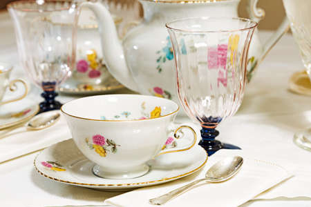 Antique floral tea set on the table photo
