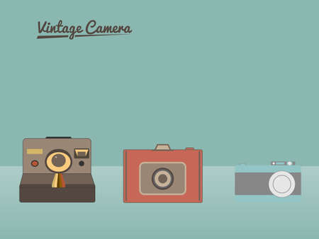 Group of vintage cameras against pastel background.