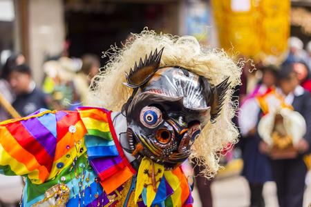 Pisac, Peru - July 16, 2013  masked dancers at Virgen del Carmen parade