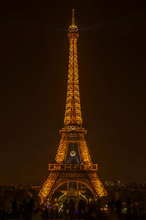 nightime: Paris, France - May 31, 2014  Eiffel Tower at nightime with Roland Garros giant tennis ball