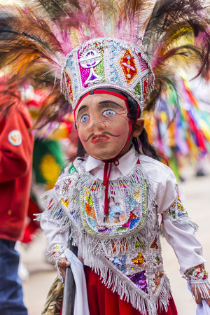 pisac: Pisac, Peru - July 16, 2013  masked kid dancer at Virgen del Carmen parade Editorial