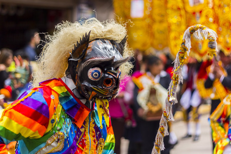 religious clothing: Pisac, Peru - July 16, 2013  masked dancers at Virgen del Carmen parade Editorial