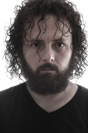 inexpressive: one bearded man portrait on white background