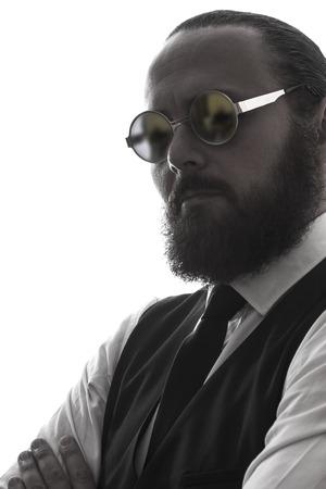 studio  isolated: one elegant serious bearded man wearing sunglasses portrait on white background