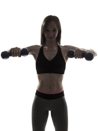 sport fitness: one beautiful fitness woman fitness sport excercising with dumbbells silhouette on white background Stock Photo
