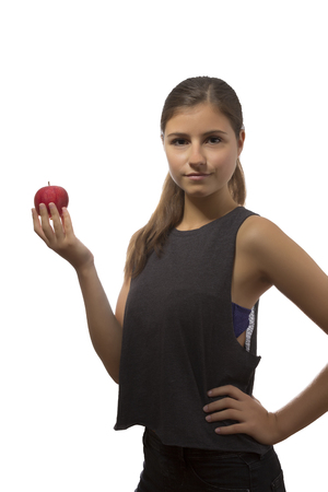 cute teen girl: one beautiful teenage girl holding one red apple in white background