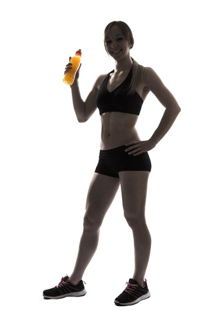 energy drink: one beautiful fitness woman sport drinking energy drink silhouette on white background