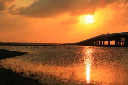 longest: Sunset at the longest bridge of Thailand