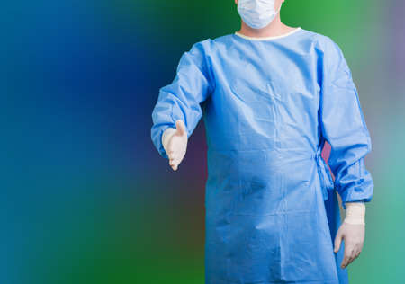 a surgeon in uniform with mask and gloves photo