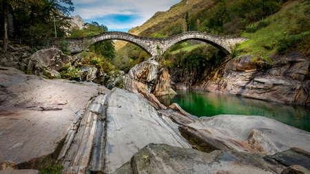 mystic place: an old bridge in the stunning swiss alps
