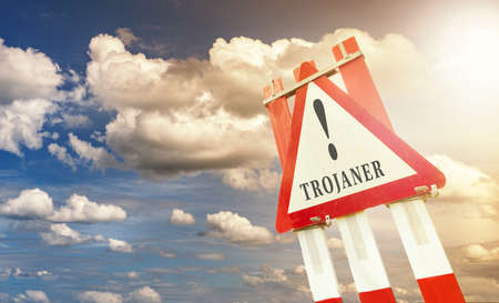 trojaner warning sign road construction road sign in front of sky with clouds Stock Photo