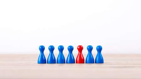 Game board figures on a row with geek 版權商用圖片