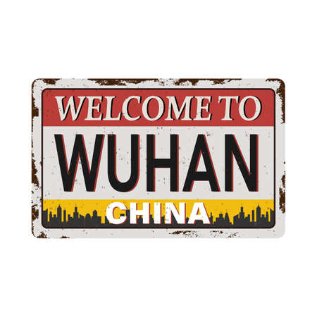 Vintage grunge Welcome to WuhanChina rusted plate on a white background