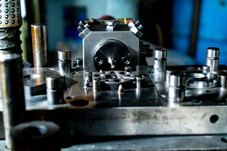 Sheet Metal Stamping Tool Die for Automotive Precision Parts on the Numeric Control Milling Machine Table. Tandem Stamping System. At a High Quality Technology Factory. Stock Photo