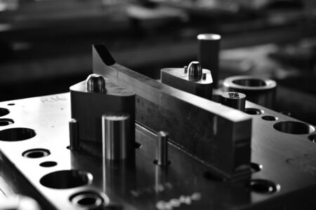 Sheet Metal Stamping Tool Die for Automotive Precision Parts on the Numeric Control Milling Machine Table. Tandem Stamping System. At a High Quality Technology Factory.Black and White Photography.