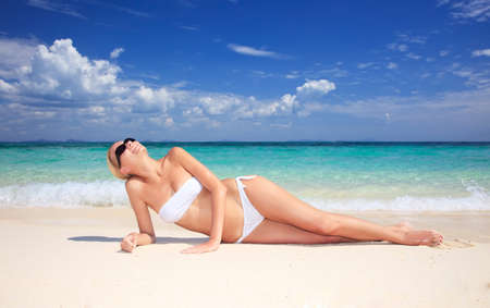 Beautiful Young  girl relaxing on the beach.