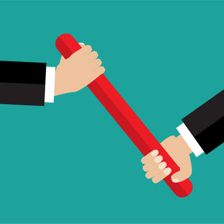 relay race: Businessman hand passing the baton in a relay race. Partnership or teamwork concept