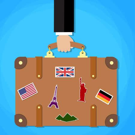 Maletín con pegatinas en la mano. Ilustración de viajeros plana. maleta de viaje con pegatinas cobardes sobre fondo claro. Concepto del recorrido. Ilustración de vector