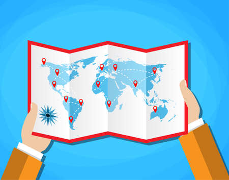 folded hands: Cartoon hands hold folded paper map of world with color point markers. World map countries. vector illustration in flat design on blue background