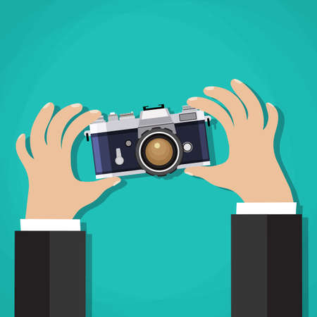 correspondent: Flat illustration of Retro  photo camera with hand holding it. Vector illustration of a hand holding Vintage  camera for your design