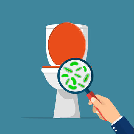 Toilet hygiene concept. Hand with magnifying glass showing bacteria in the toilet bowl Stock Photo
